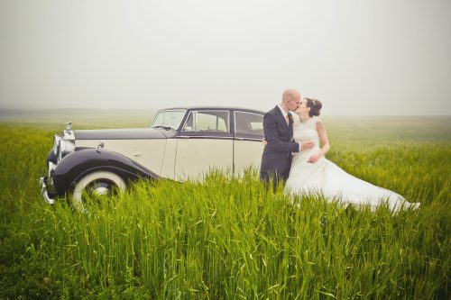 1950-rolls-royce-silver-wraith -couple with car in a field 2