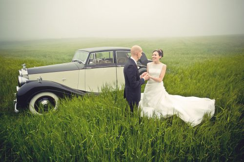 1950-rolls-royce-silver-wraith-couple with car in a field