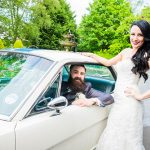 Joe and Katie cooper loving our 1966 Mustang GT 350 at their wedding