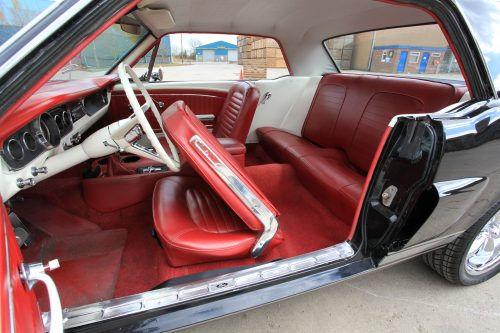 1965 black ford mustang with red and ivory interior